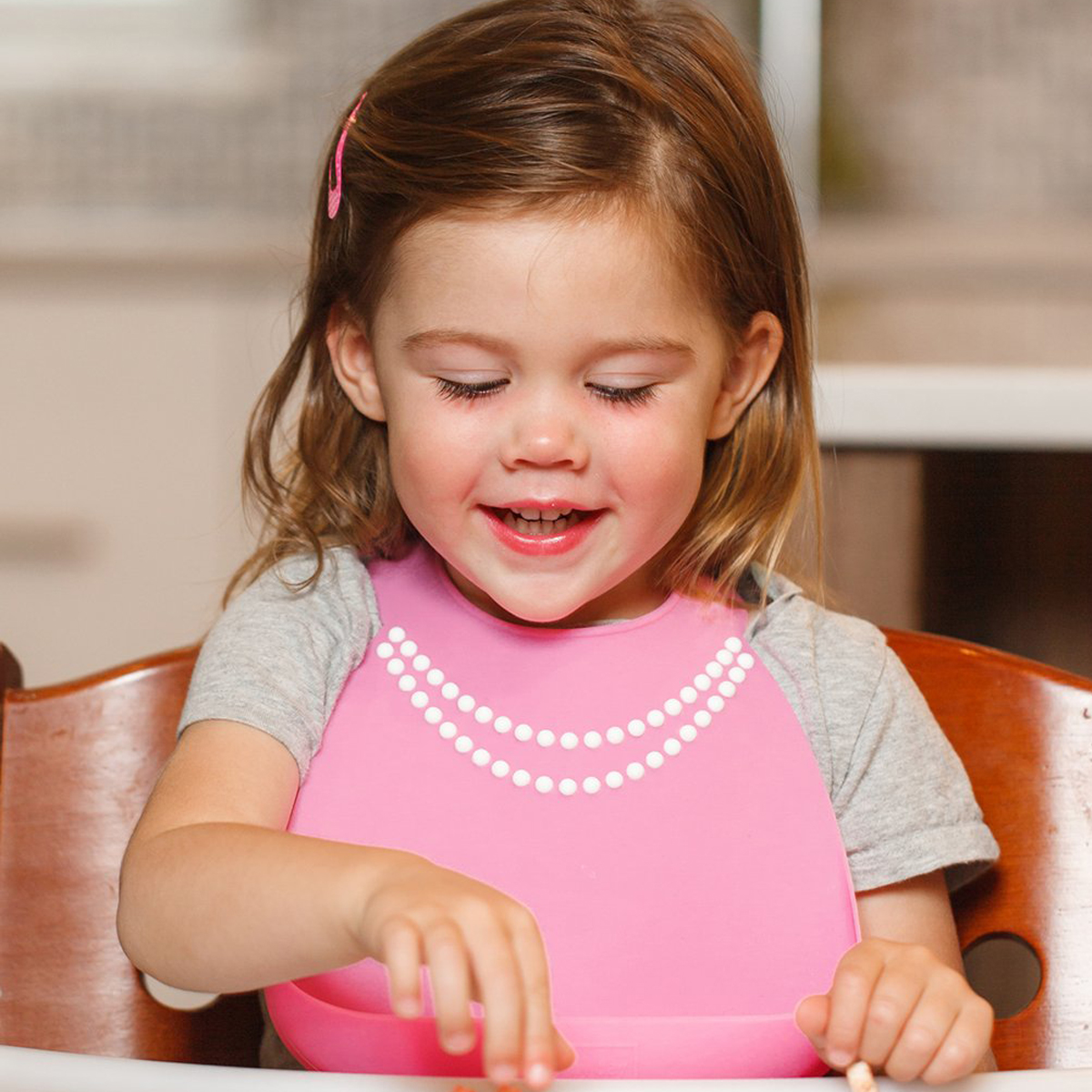 Make My Day Silicone Bucket Bib in Pink with pearls on girl