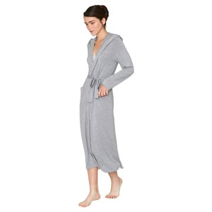 A woman wearing a grey bamboo robe by recliner