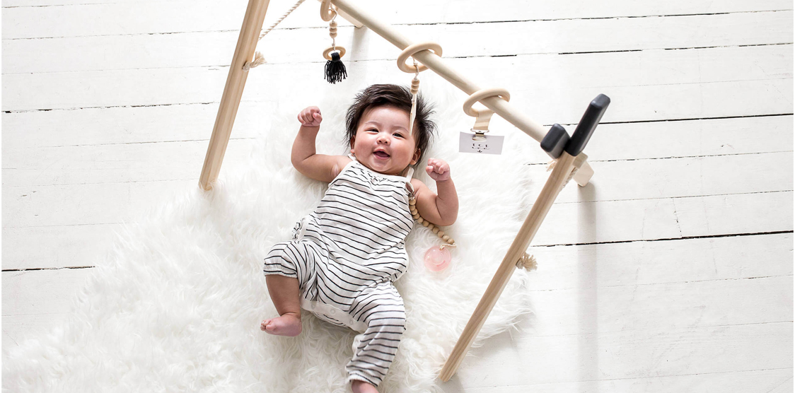 baby using a play gym