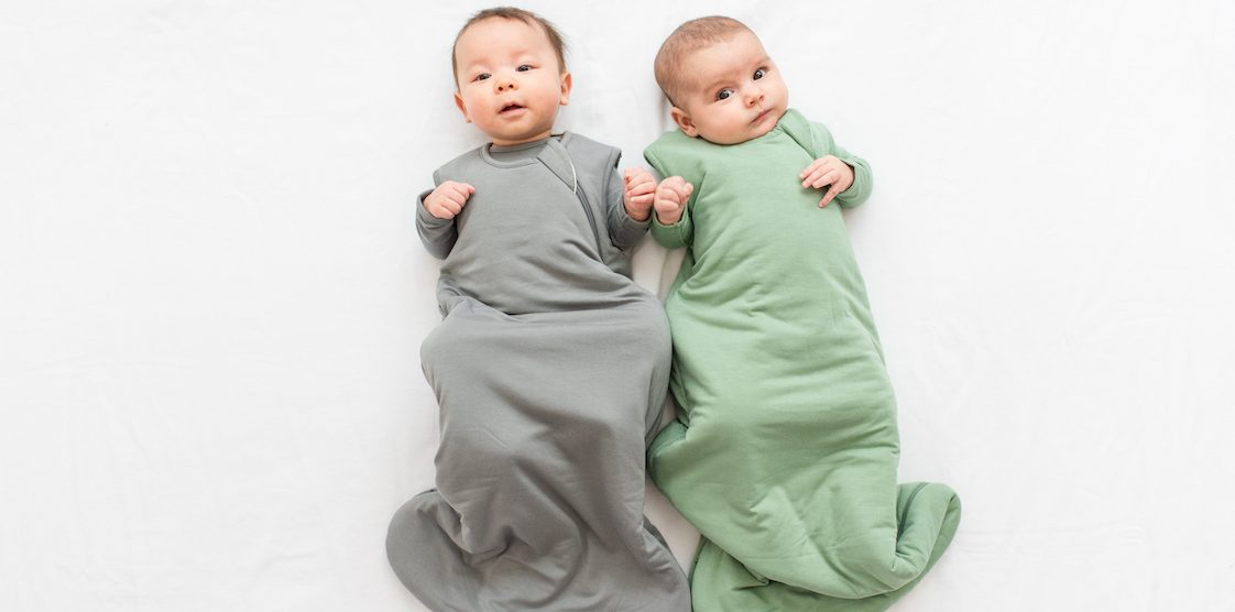 Two babies wearing Kyte Baby Sleep Bags