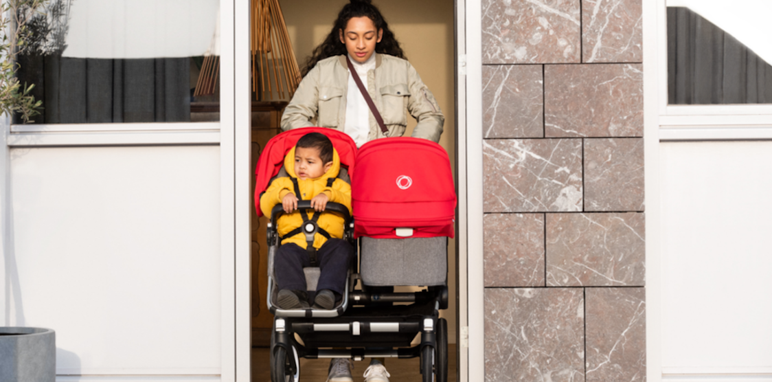 A mother pushing her kids in the Bugaboo Donkey 3 stroller