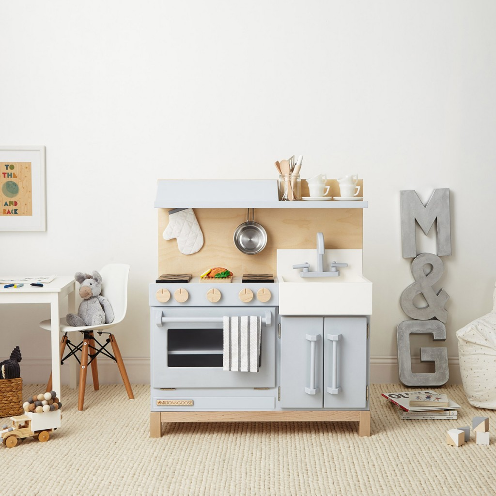 A child's playroom showcasing the milton and goose play kitchen