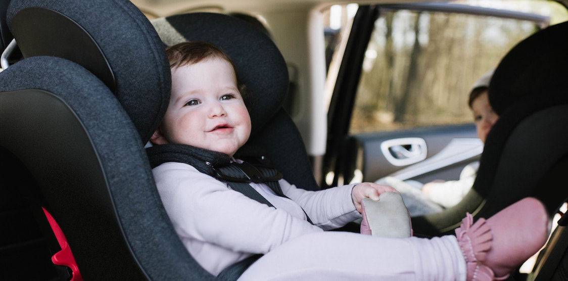 A baby in the Clek Foonf Car Seat