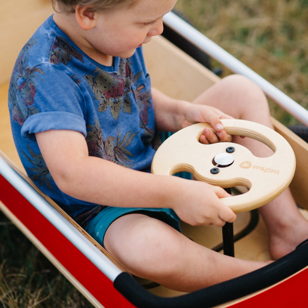 A child playing in the Wishbone Wagon