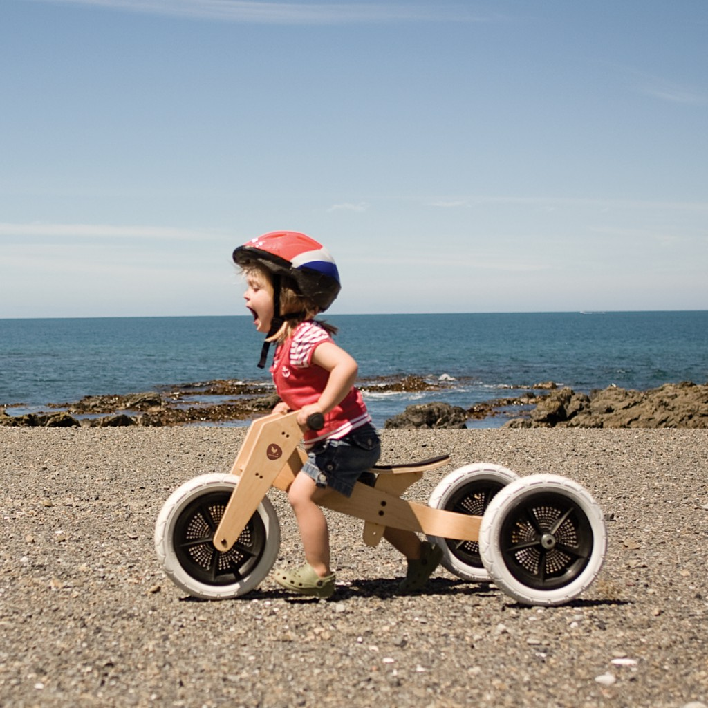 A child riding the wishbone 3-in-1 bike