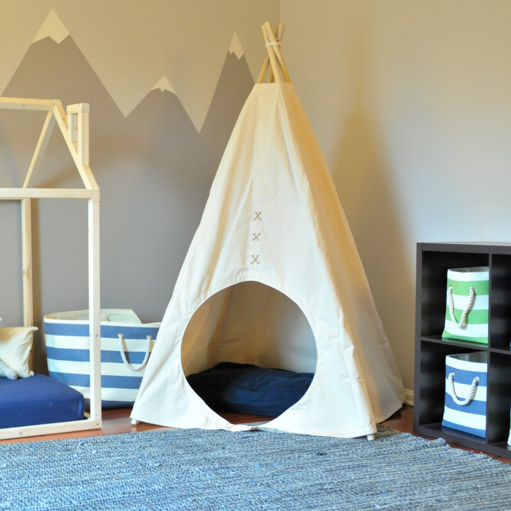 A childs room decorated with the E&E Teepees Natural Circle Teepee