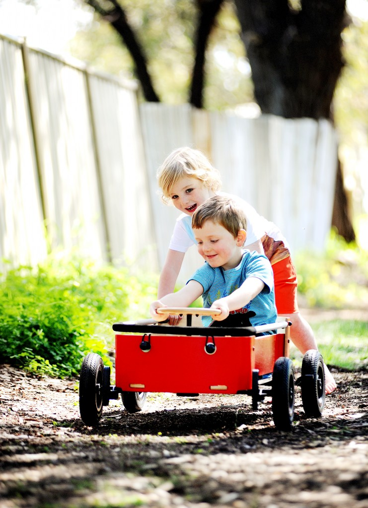 Two kids playing in the wishbone wagon