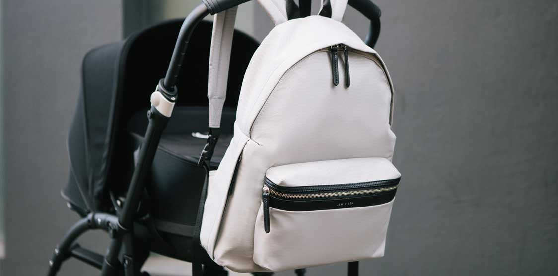 A backpack diaper bag and a stroller, both gifts for second babies.