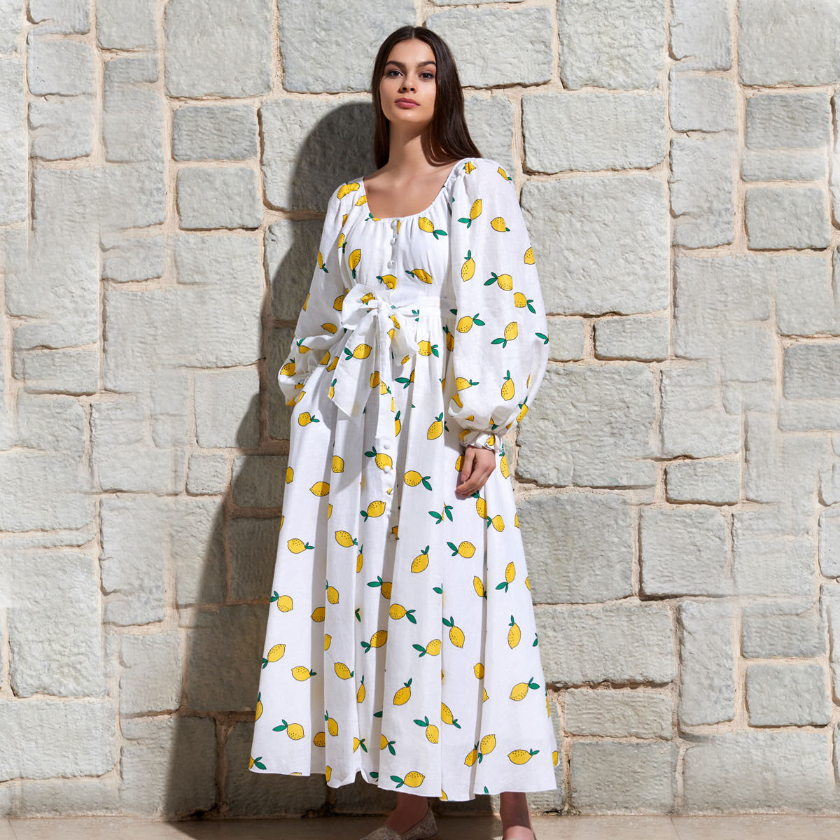 Gul Hurgel Women's Peasant Sleeve Dress in White with Lemons on woman