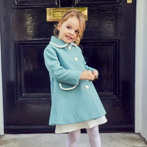 The Great British Baby Company Kensington Coat in Duck Egg on girl