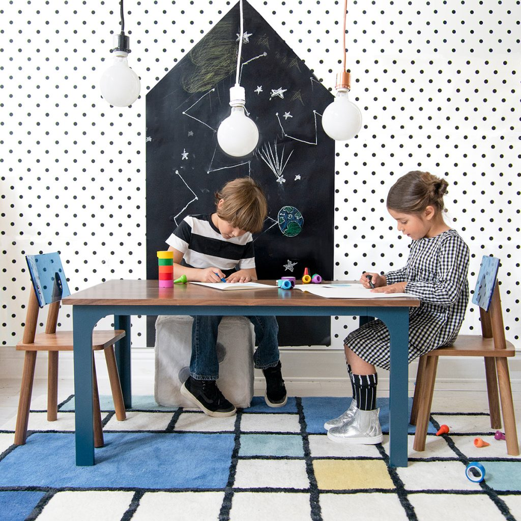 Kids doing craft at a Nico & yeye wood table