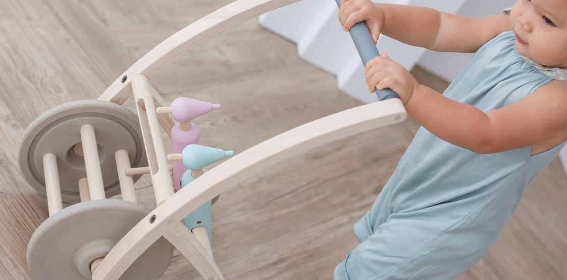 Toddler with Wooden plastic free walker toy