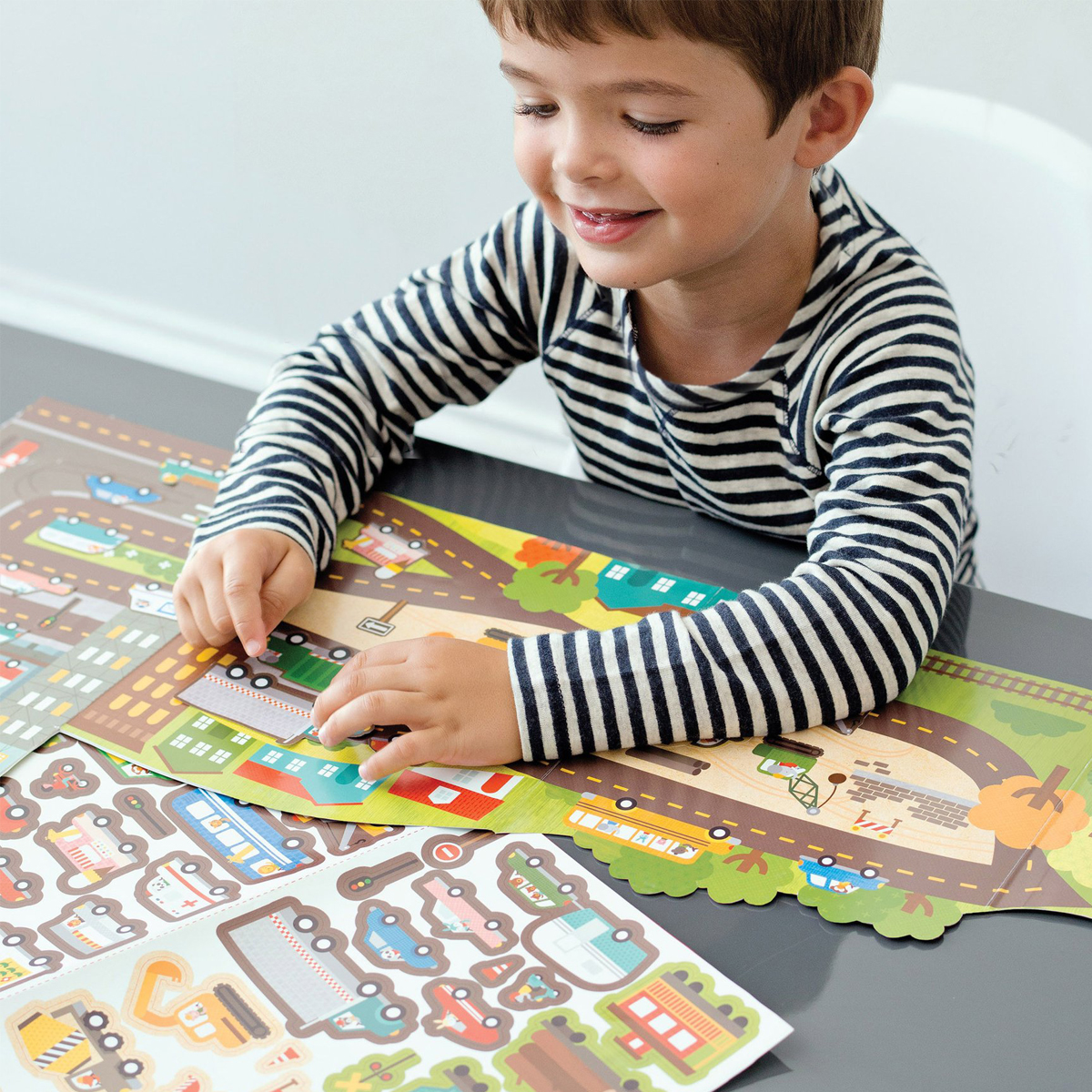 Petit Collage Roads & Rails Sticker Activity Kit with boy