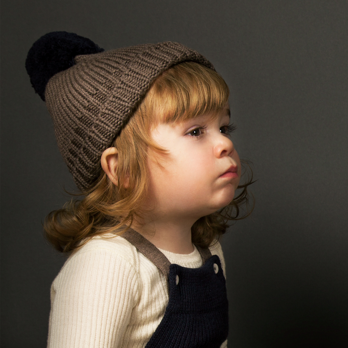 Mabli Knits Otto Bobble Beanie in Walnut and Soft Navy on baby
