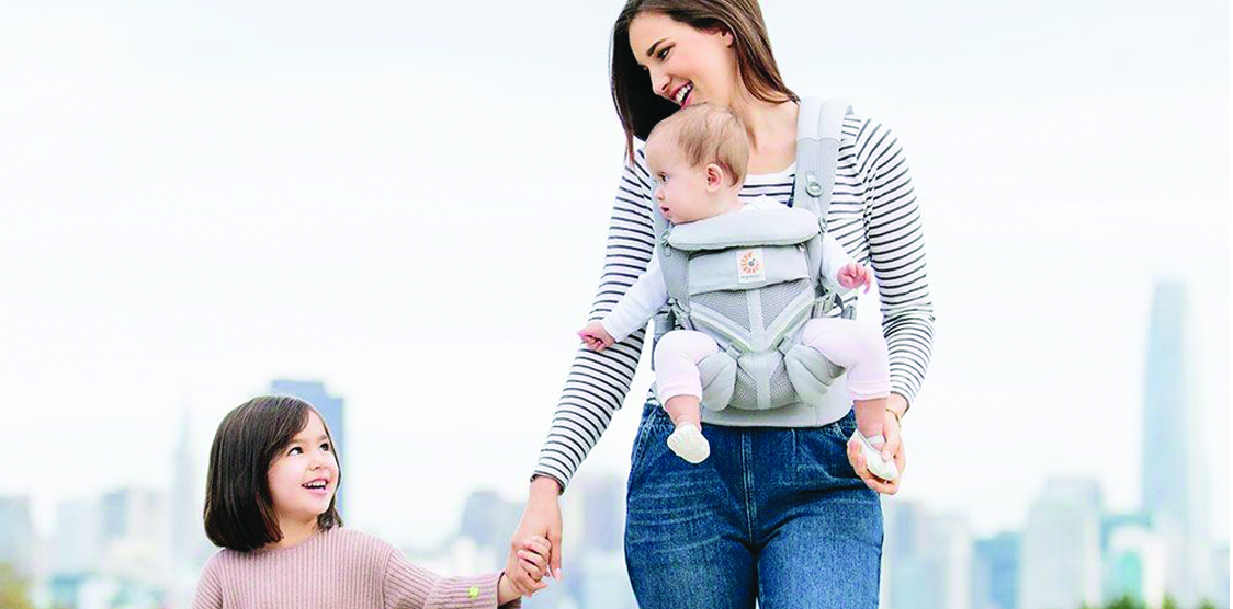 Mom wearing an ergonomic baby carrier