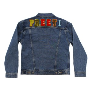 Levi's Women's Denim Trucker Jacket with Earth Tone Alphabet patches on back
