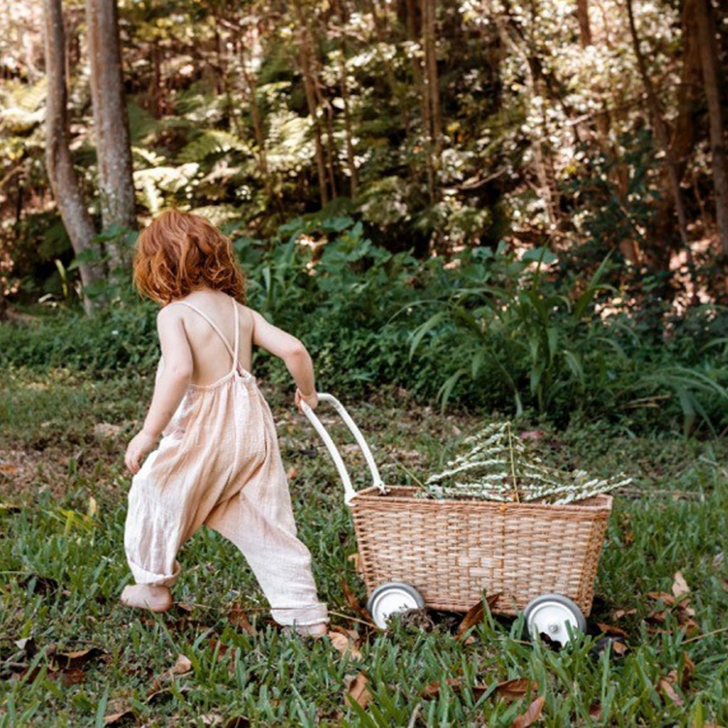 Olli Ella Strolley Wheeled Basket in Natural with girl