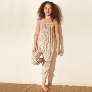 Cool Change Delilah Jumpsuit in Vanilla on girl