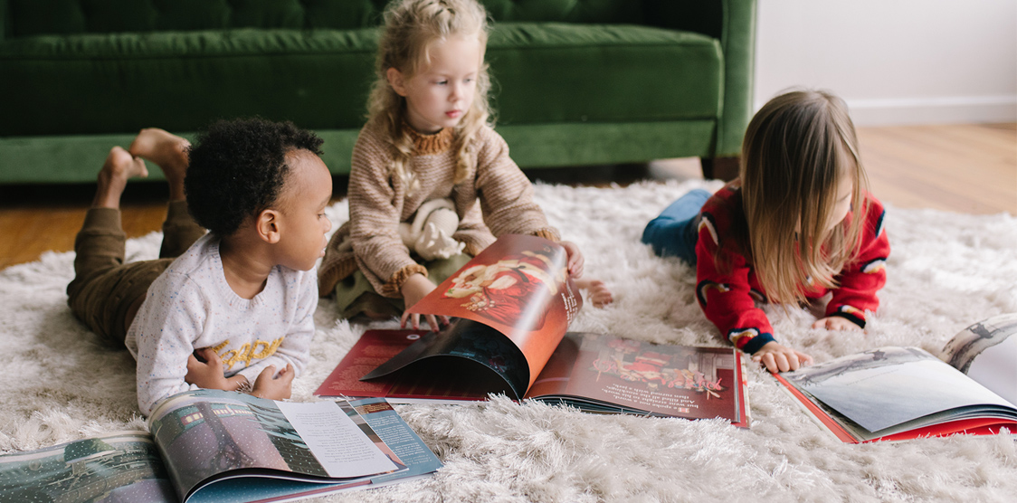 Toddlers reading Christmas books for kids