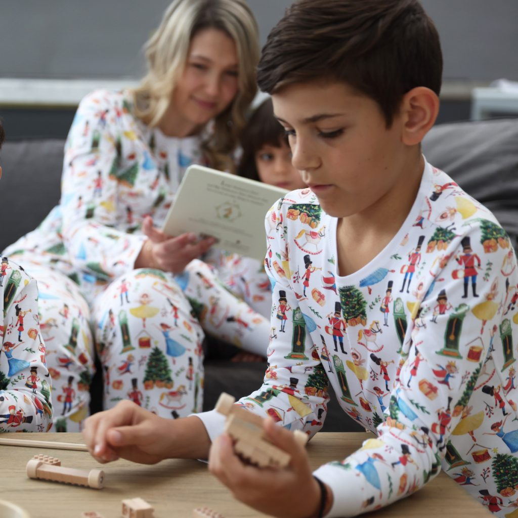A boy wearing HART + LAND Vintage Christmas PJs