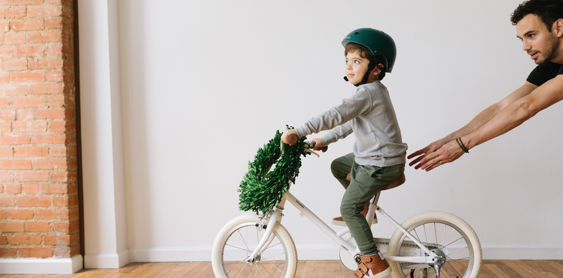 boy riding on a bike that was a Christmas gift.