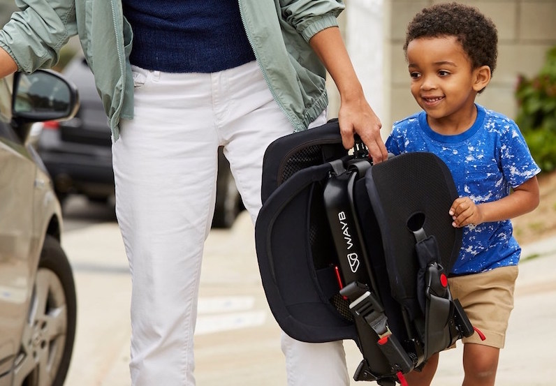 A child helping his mom carry the WAYB pico travel car seat