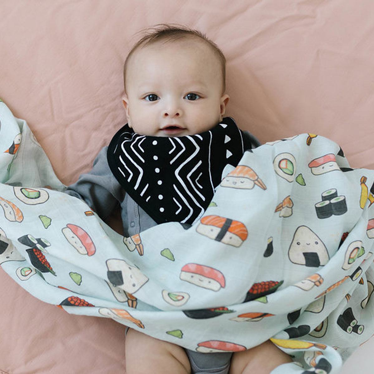 Loulou Lollipop Swaddle in Sushi with baby