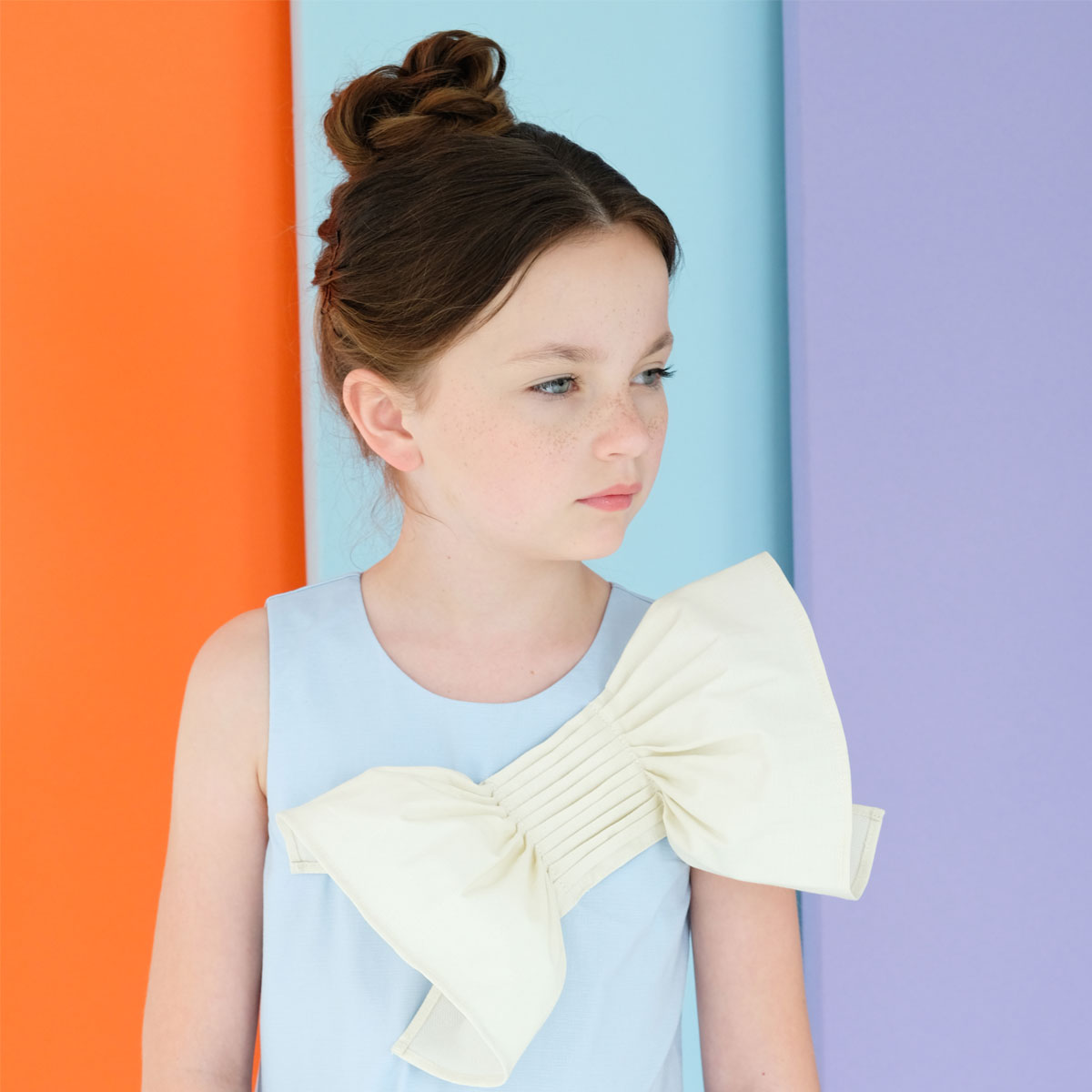 Moque Reese Dress in Blue with Oversized chest bow in White on girl