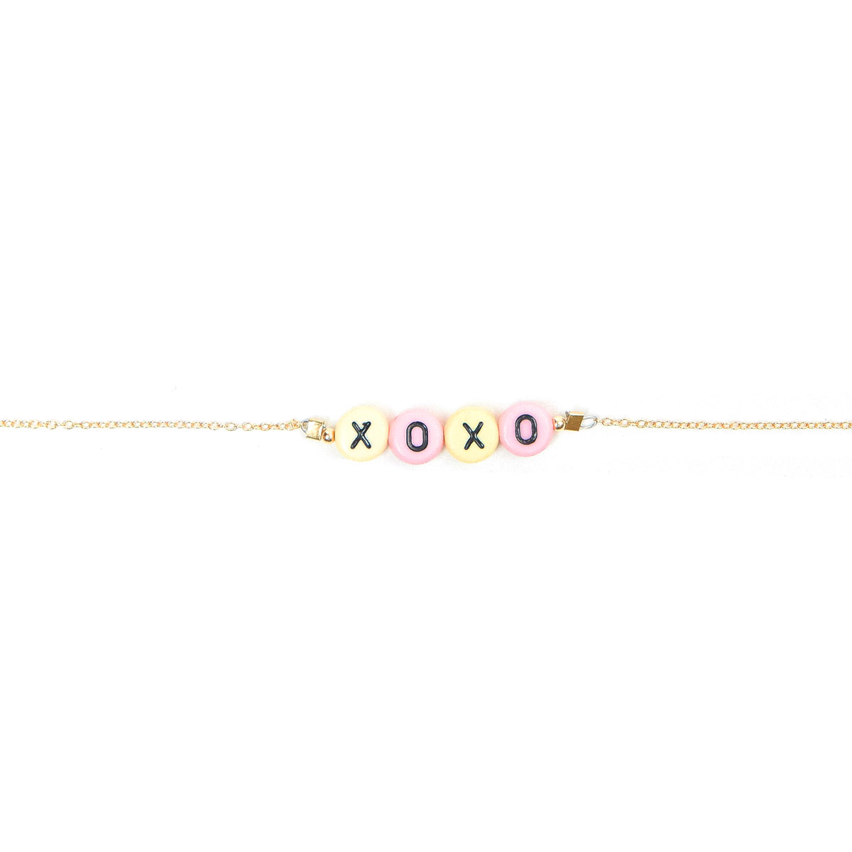 "Stella and Bow Gold Bracelet with plastic letter beads reading ""XOXO"" in pastel colors"