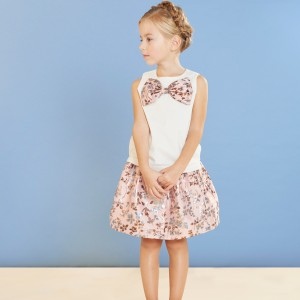 Hucklebones Sleeveless Bow Shell Top in White with Metallic Blossom on girl