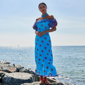 Gul Hurgel Women's Linen Off the Shoulder Dress in Blue with Red Crabs on woman