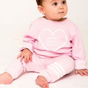 Sol Angeles Waves French Terry Jogger Pant in Seashell Pink on baby