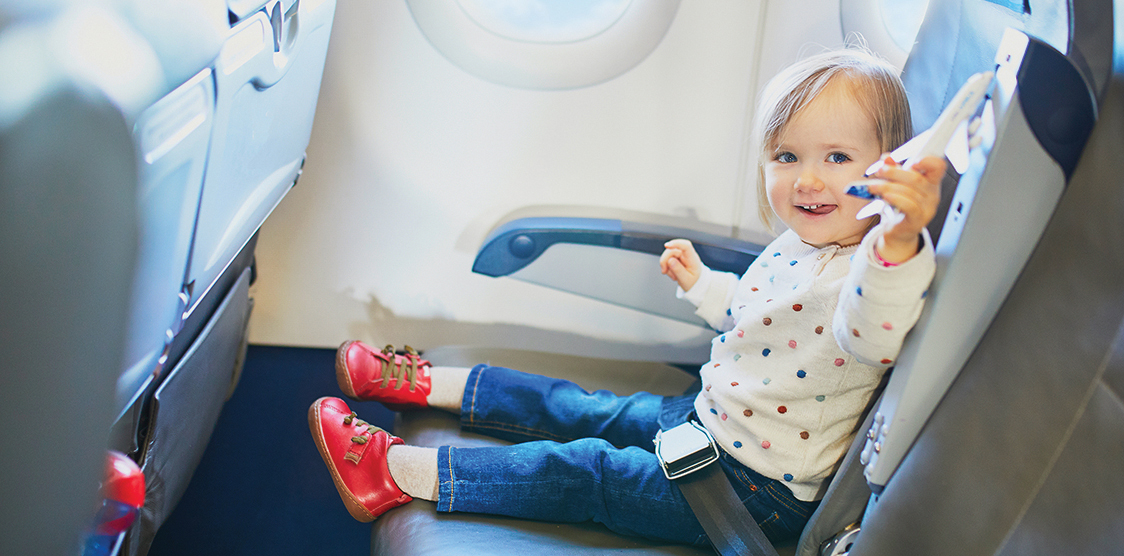 A child playing with a toy on an airplane