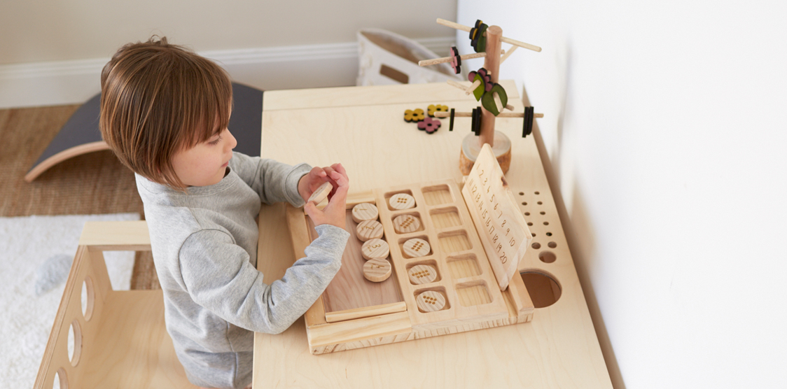 girl playing with Wooden numbers tray