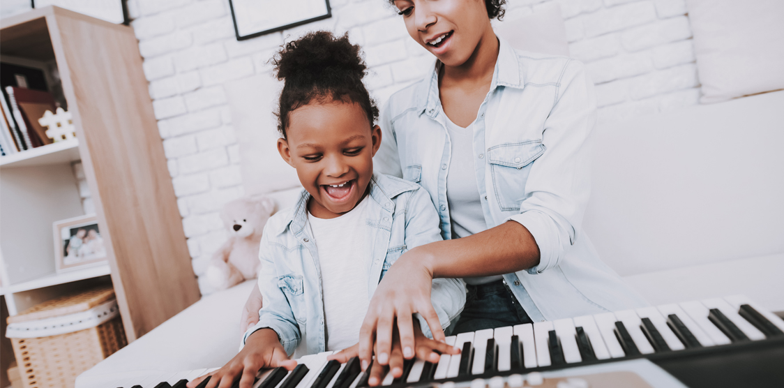 mom and daughter playing keyboard