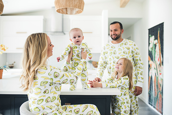 family in matching avocado pjs