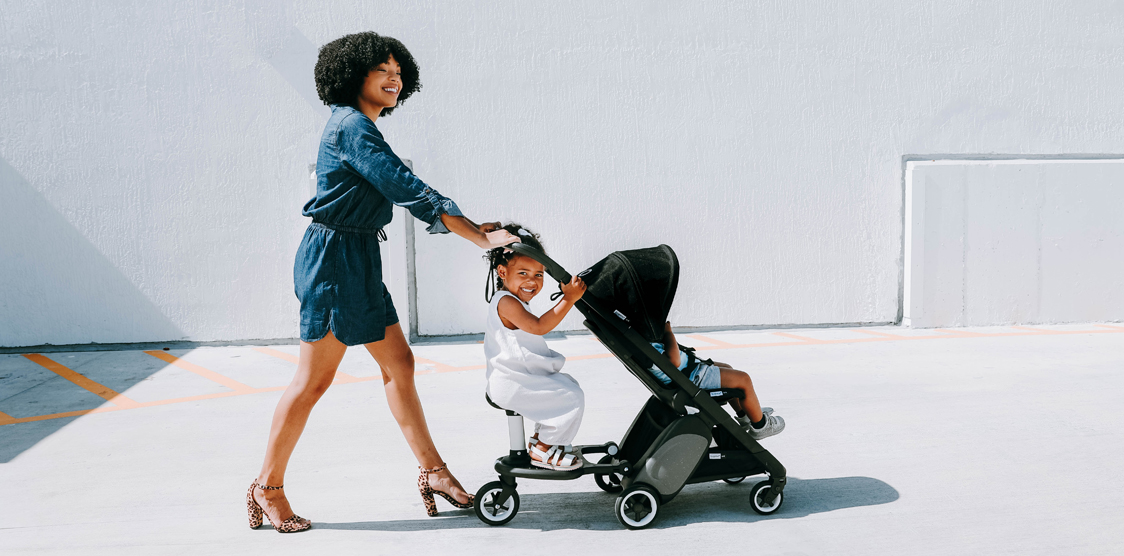 african american family pushing stroller