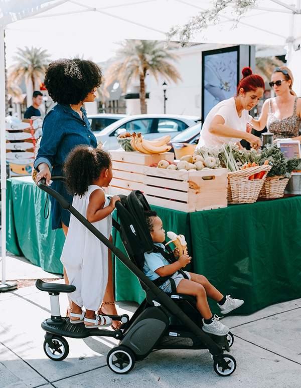 mom pushing stroller at farmer's markets