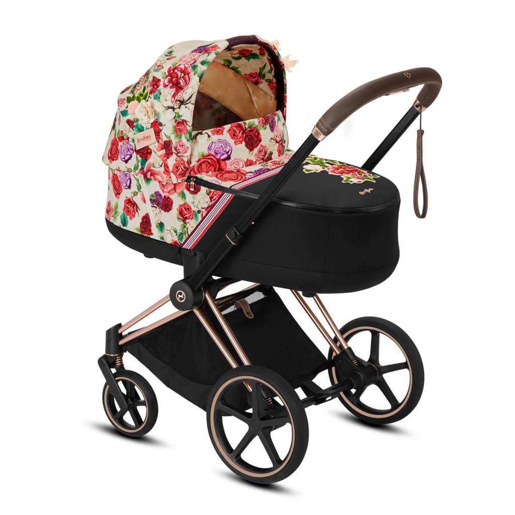 Cybex Priam Lux Carry Cot in Light Spring Blossom on Stroller