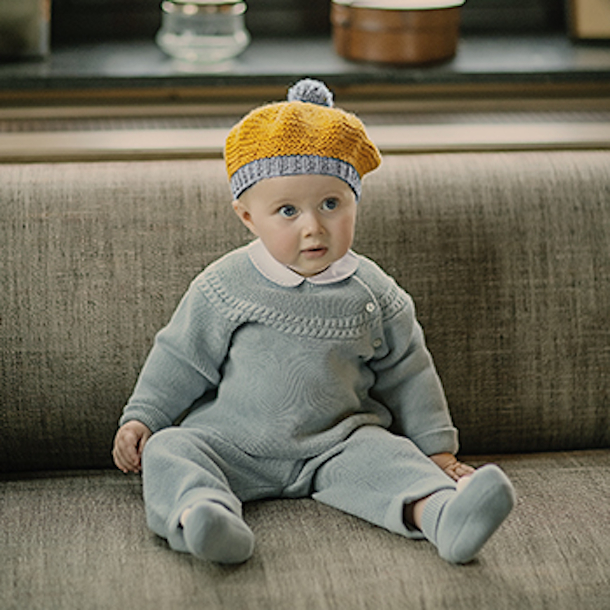 baby in tartine et chocolate knit outfit and hat