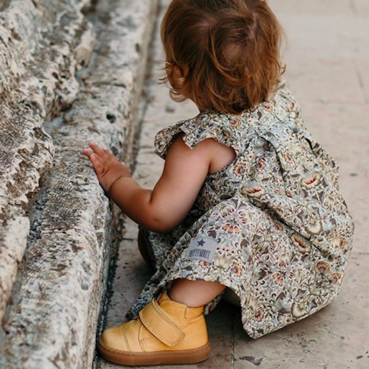 little girl wearing petit nord shoes