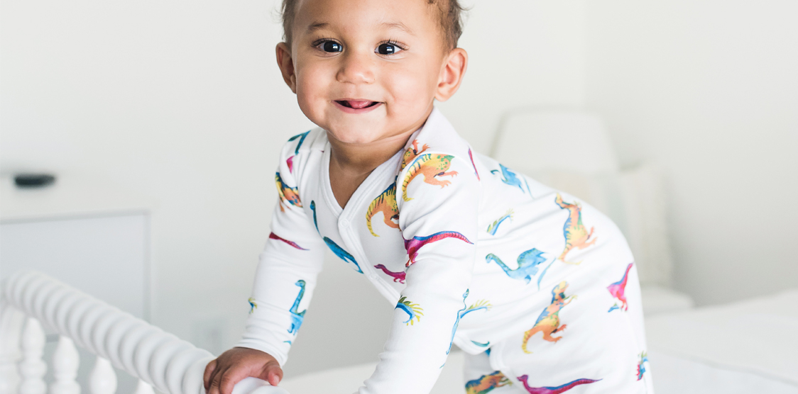cute baby in dinosaur pjs