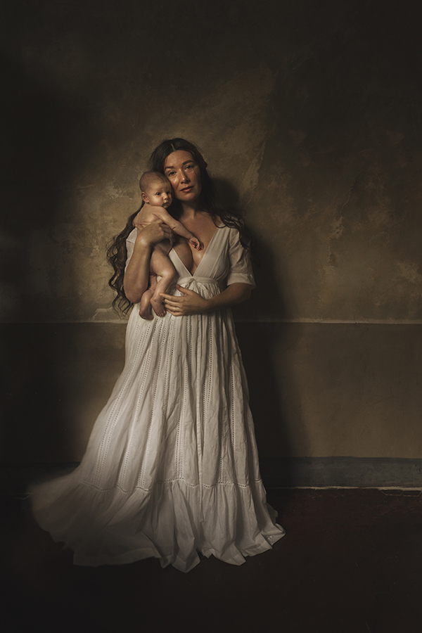 mother posing with newborn baby