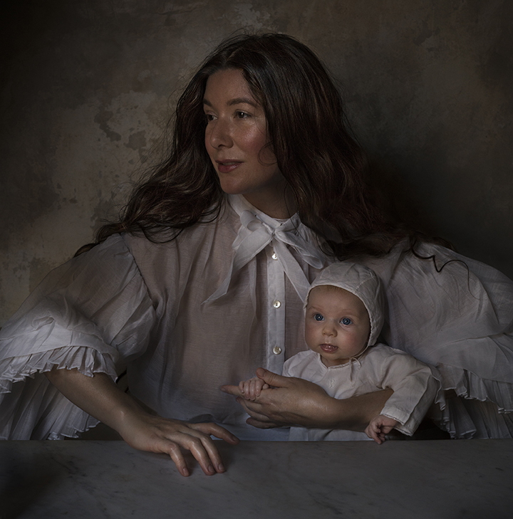 old fashioned portrait of mother and baby