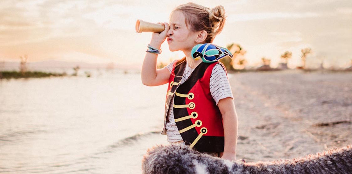 A little girl wearing the Lovelane Designs Halloween Pirate Costume