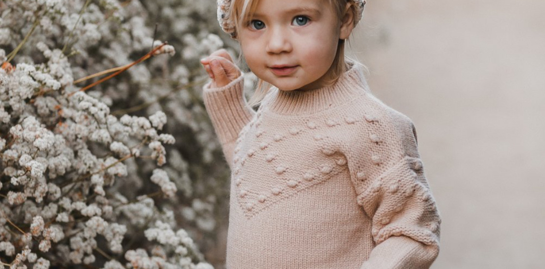 cute toddler in knitted sweater