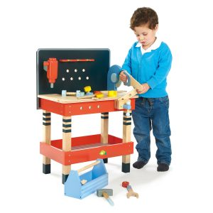 Little Boy playing with Tender Leaf Tool Bench