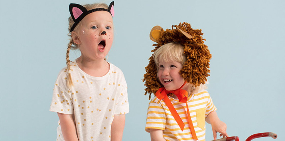 happy kids wearing halloween headdresses
