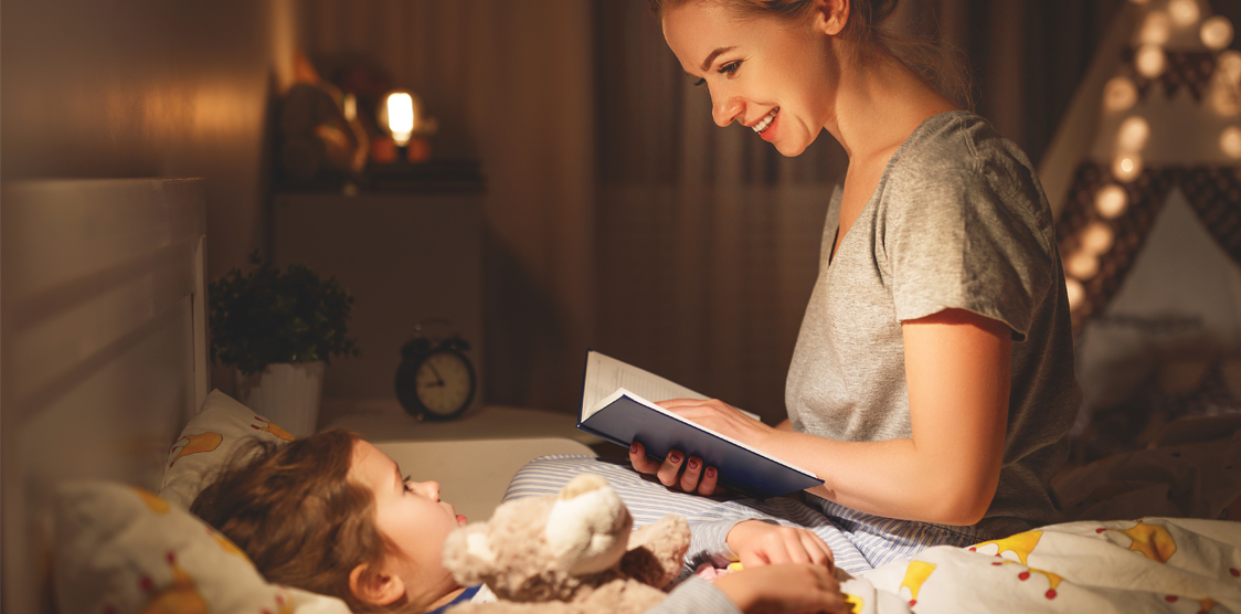mom reading bed time story to child