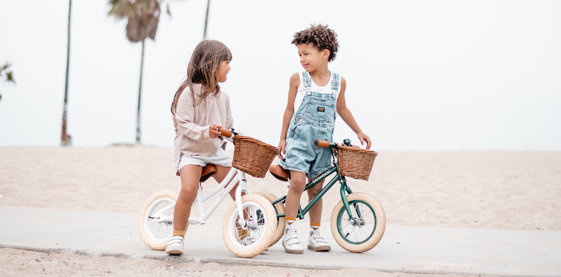 Kids on Banwood Balance Bikes at the beach
